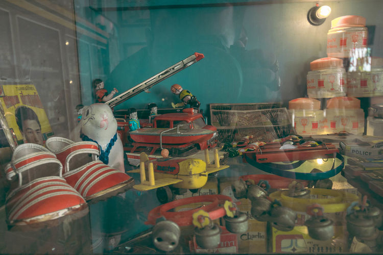 High angle view of various toys on table at store