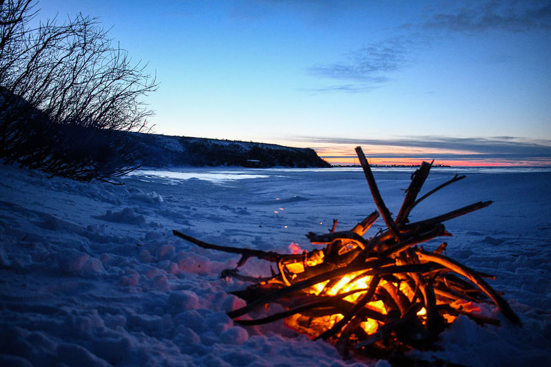 High angle view of bonfire on snow covered land