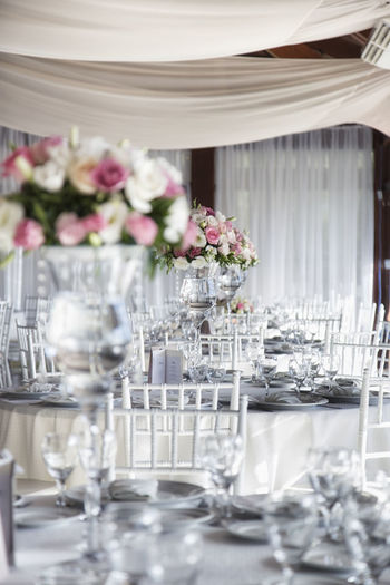 Wedding Reception Dinner Dinner Marriage Ceremony Married Reception Reception Hall Arrangement Close-up Day Dining Table Drinking Glass Elégance Flower Focus On Foreground Fragility Hotel Indoors  Napkin No People Place Setting Plate Restaurant Table Vase Wedding Wineglass