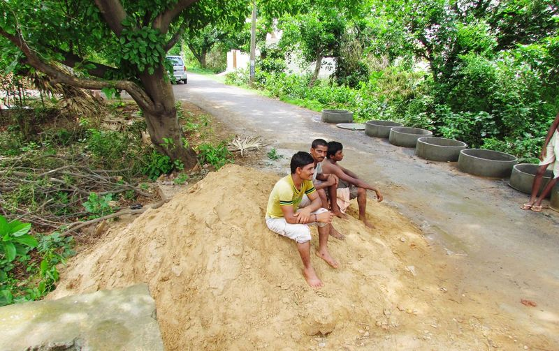 MEN SITTING ON SAND HEAP.... Sitting Smiling Looking At Camera Young Men Heap Of Sand Men Relaxation Chit Chatting Tree Friendship Togetherness Bonding