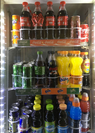 Refrigerator with drinks Abbundance, Bottle Bottles Choice Coca Cola Cold Temperature Cooling  Drink Energy Drink Fanta Illuminated Indoors  Inside Of Large Group Of Objects Multi Colored No People Red Bull Refreshment Refrigerator Soda Variation