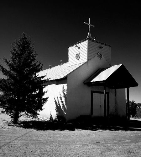 """""""God Stopped In Nogal"""" A tiny community church in the Village of Nogal, NM, basks in the late afternoon sun. Blackandwhite Photography Black & White Black And White Blackandwhite Churches Church Tree Architecture Building Exterior Built Structure No People Outdoors Day"""