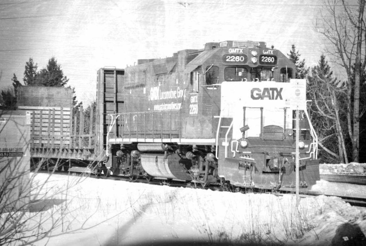 TRAIN ON RAILROAD TRACK IN WINTER