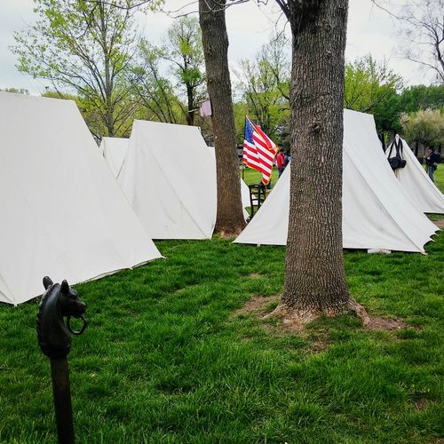 Taking Photos Civil War Era Tents Civil War HistoryTelling Stories Differently Tents American Flag Horsehead Outdoor Photography American Life Eyeem Photography EyeEm Gallery Spring Is In The Air No People 1850's Homestead Green Grass 🌱 Phoneography The Irwin Collection Getty Images