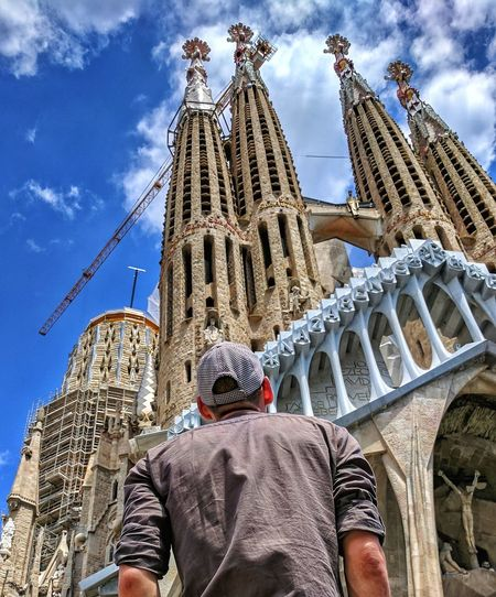 Low Angle View Architecture Built Structure Sky Cloud - Sky Travel Destinations Day Outdoors History Building Exterior Men One Man Only One Person Real People Only Men Adult Barcelona SPAIN Adults Only People City Sagrada Sagrada Familia Adults Only People City