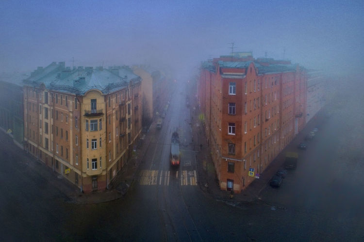 Panoramic view of street in city against sky