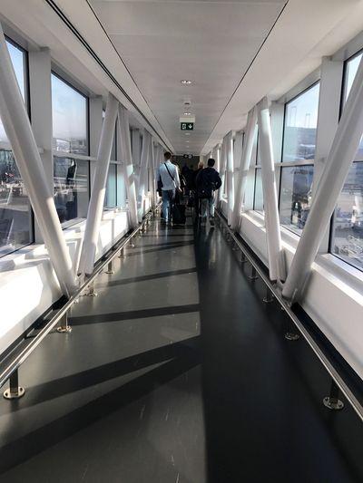 People walking on escalator in airport
