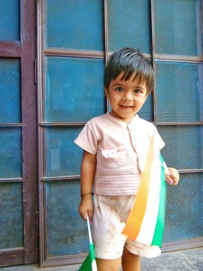 indian baby holding national flag of India Holding Flag Flags National Nation Nationalism Patriotism Patriotic Kid Girl Indian Indian Culture  Baby Child Childhood Portrait Smiling Looking At Camera Boys Happiness Standing Girls Door Children Preschooler Innocence Babyhood One Baby Boy Only One Baby Girl Only Little