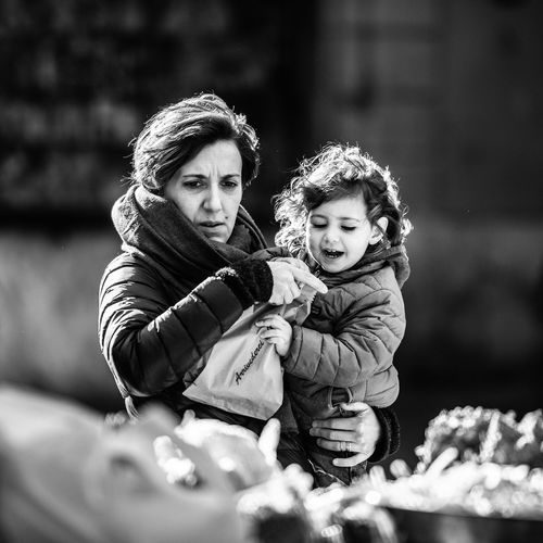 """""""Shopping with Mom"""" Child Childhood Family Real People Women Females Togetherness Parent Lifestyles Selective Focus Looking At Camera Leisure Activity Portrait Winter Bonding Girls Family With One Child Warm Clothing Daughter Outdoors Innocence EyeEm Best Shots EyeEmNewHere My Best Photo The Art Of Street Photography The Portraitist - 2019 EyeEm Awards"""