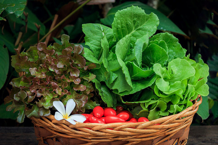 Close-up of vegetables in wicker basket on table