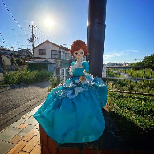 Portrait of woman against blue sky