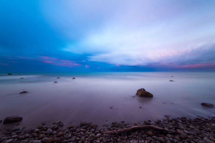 Beach Beauty In Nature Cloud Dramatic Sky Flow  Horizon Over Water Landscape Long Exposure Motion Movement Nature New Zealand No People Ocean Outdoors Rocks Sand Scenics Sea Sky Sunset Tranquil Scene Travel Travel Destinations Water