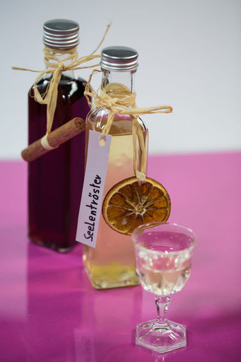 Liqueur Indoors  Still Life Drink Food And Drink No People Refreshment Close-up Pink Color Container Alcohol Glass Text Food Table Freshness Transparent Focus On Foreground Glass - Material Jar Bottle Purple