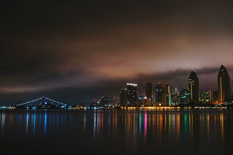 San Diego nights Nikon NIKON D5300 Life Love San Diego EyeEm Selects Building Exterior Architecture Built Structure Water Sky Adventures In The City Night Illuminated City Cityscape Skyscraper Reflection Waterfront Building Modern Sea Outdoors Cloud - Sky HUAWEI Photo Award: After Dark