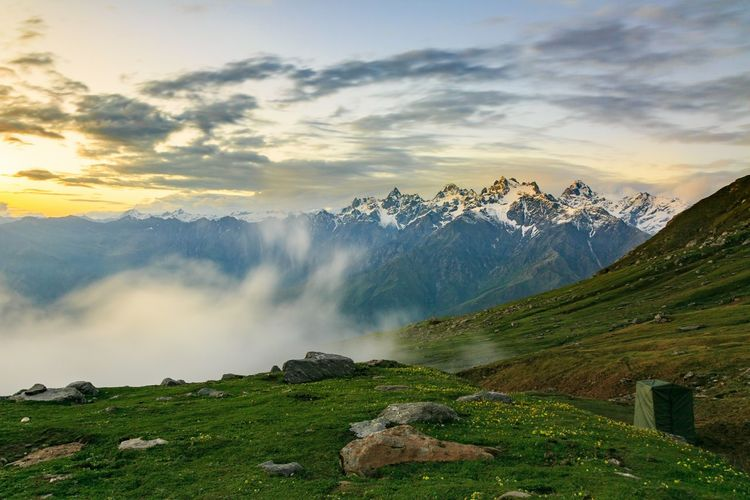 Trekking in the Land of Gods. Mountain Cloud - Sky Landscape Sunset Nature Fog Outdoors Scenics Summer Rural Scene Agriculture Beauty No People Mountain Range Field Gold Colored Water Beauty In Nature Sky Forest clicked at Sar Pass, Himachal Pradesh, India. Let's Go. Together.