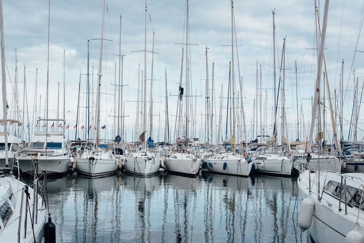 Harbor Harbour Nautical Vessel Transportation Water Mode Of Transportation Sailboat Moored Pole Sky Mast No People Nature Cloud - Sky Day Sea Reflection Travel Waterfront Yacht Outdoors Marina Sailing Yachting Scenics Boat Deck Sailor Regatta Wake - Water Sailing Boat
