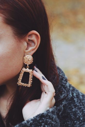 Close-up of young woman wearing earring