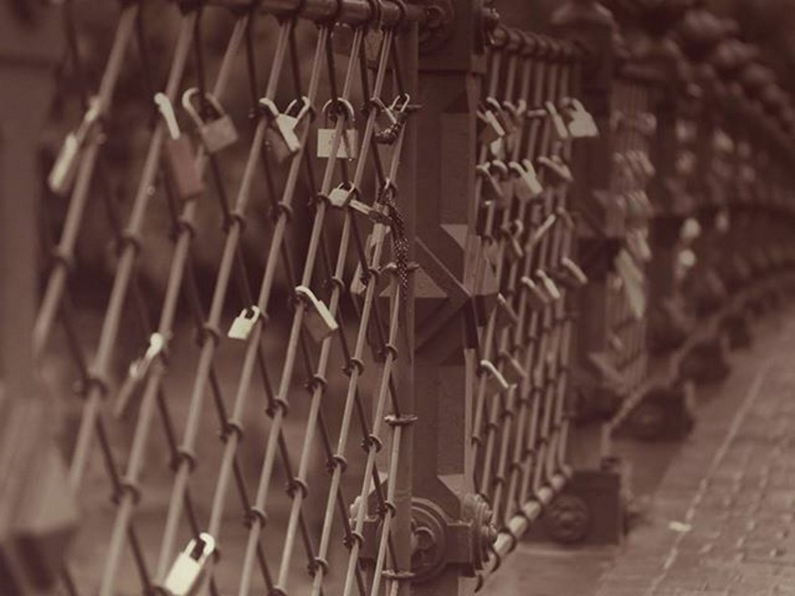 metal, indoors, built structure, wall - building feature, architecture, pattern, design, metallic, protection, close-up, security, safety, gate, no people, old, focus on foreground, fence, building exterior, day, hanging