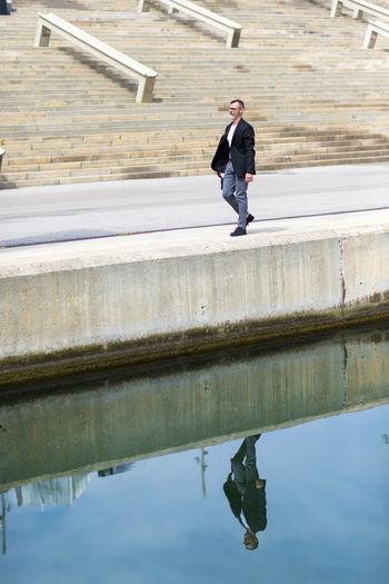 Full length of man walking at harbor