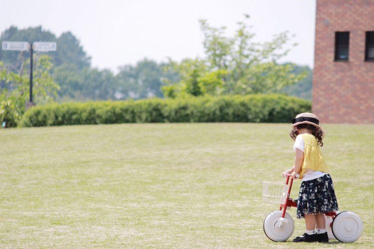 Girl Playing On Grassy Field