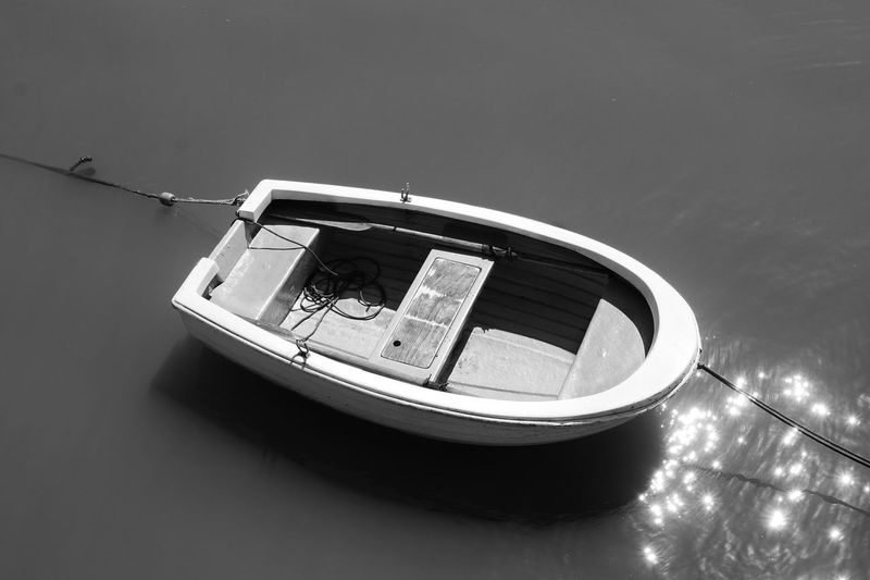 High angle view of boat moored in lake against sky
