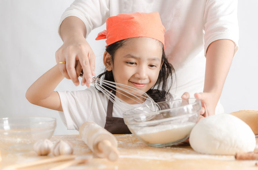 Bowl Childhood Domestic Kitchen Domestic Life Dough Egg Elementary Age Flour Food Food And Drink Front View Headshot Holding Indoors  Ingredient Kneading Lifestyles Making Mixing Mixing Bowl One Person Preparation  Rolling Pin Table Wire Whisk