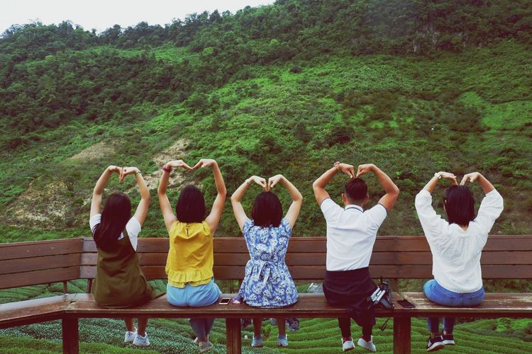 Love is all around Friendship Young Women Togetherness Tree Men Bonding Standing Women Human Arm Arms Raised Friend
