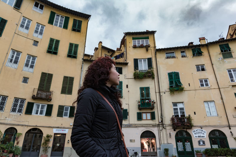Sisters Adult Adults Only Beautiful Building Exterior Built Structure City Cloud - Sky Curly Hair Day Enjoying The View Italy Italy❤️ Joy Looking Lucca One Person Outdoors People Tourism Travel Travel Destinations Woman Traveling Home For The Holidays