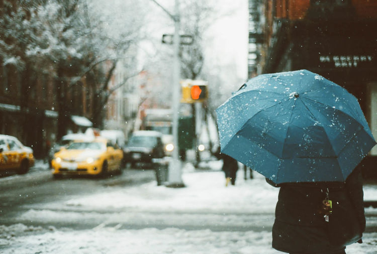 Adult Car City City Life City Street Cold Temperature Human Body Part New York People Snow Snowing Street Taxi Warm Clothing Weather Wet Winter