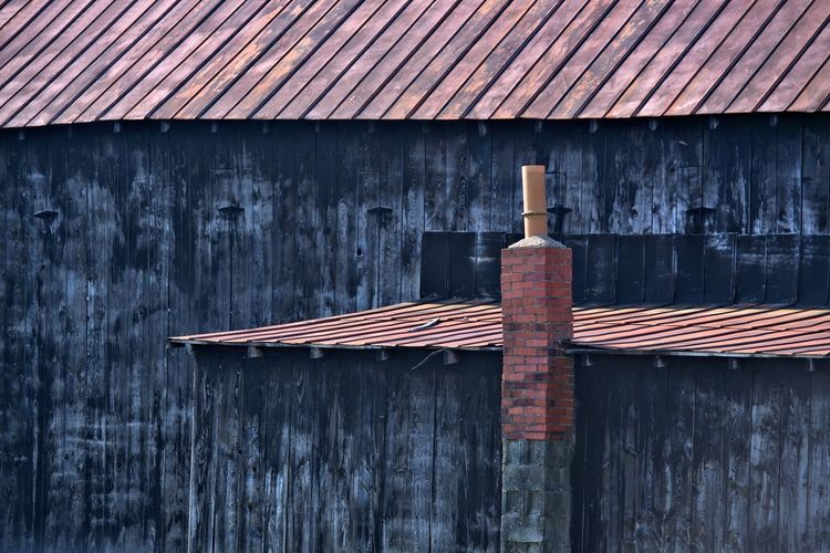 Close-up of wooden roof against building