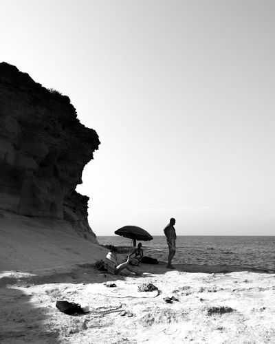 """""""se détendre"""" Series of a street photography project that focusing on the Maltese people. Sea Blackandwhite Trip Vacation Vacations Holiday Streetphotography Malta Maltaphotography People Street Black & White Blackandwhite Photography Project Old People Beach Full Length Desert Arid Climate Men Beach Rock - Object Sand Standing Sky Horizon Over Water Rocky Mountains Cliff Coast Rock"""