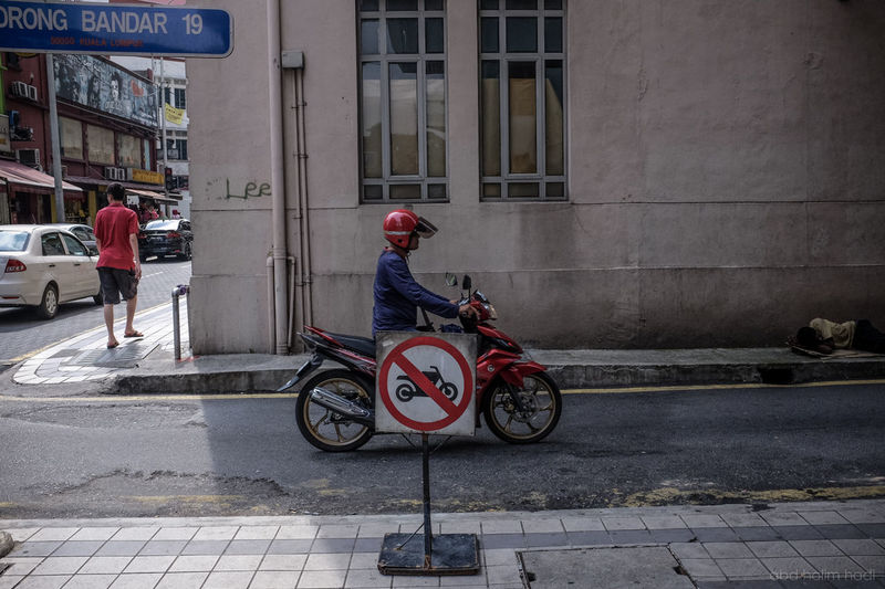 In This City Beggar Homeless Malaysia Motorcycle No Entry Sign No Parking Sign Petaling Street Rider Street Streetphotography Urban Lifestyle Urbanphotography