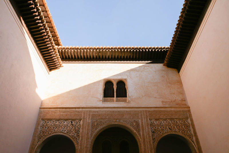 Alhambra Palace Courtyard Alhambra De Granada  Moorish Architecture Alhambra Arch Architecture Building Building Exterior Building Feature Built Structure Carved Clear Sky Courtyard  Day History Low Angle View Luxury Moorish No People Ornate Outdoors Pattern Sky The Past Travel Destinations Window