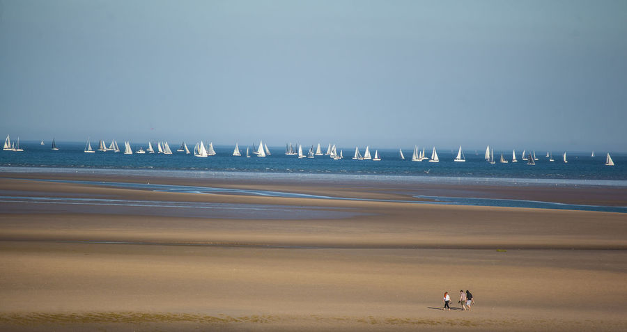Sailing competition Beach Beauty In Nature Boat City Escape Clear Sky Competition Day Family Landscape_Collection Landscape_photography Lines Nature Ocean Outdoors People People Watching Sailing Scenics Sea Sky Tide Togetherness Water