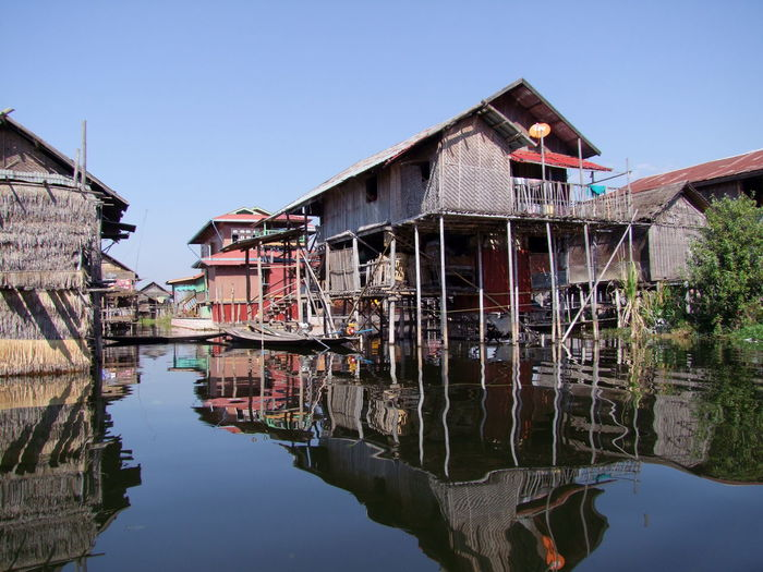 Lake Village Houses Architecture Blue Sky Building Exterior Built Structure Composition Houses On Stilts Inle Lake Lake Myanmar Nature No People Outdoor Photography Reflection Lake Reflections In The Water Shan State Sunlight And Shadows Tourism Tourist Attraction  Tourist Destination Traditional Culture Traditional Living Traditional Village Tree Water Water Village