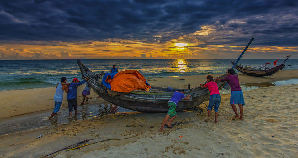 go to sea at dawn Beach Day Fisherman Fishing Net Real People Sunset Water