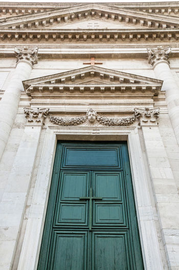 A church gate and entrance in Venice, Italy Church Church Gate Cross Green Italy 🇮🇹 Venice Italy Architecture Building Exterior Built Structure Low Angle View No People Outdoors Stone Frame Wooden Gate