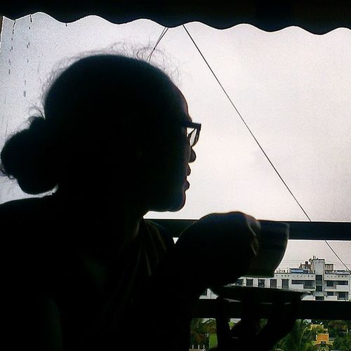 A cuppa tea in the evening rain! Monsoon Terrace Hottea Evening overcastsky lovelyweather thunder lushgreen silhouette myprettymommy