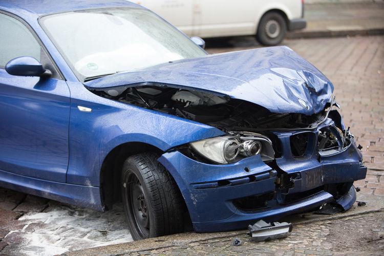 Berlin, Germany - March 23, 2018: crashed blue BMW car Cars Crash Road Traffic Transport Transportation Wreck Accident Accidents And Disasters Alcohol Broken Car Crashed Crashed Car Damaged Danger Dented Insurance Land Vehicle Mode Of Transport No People Outdoors Safe Safety Transportation