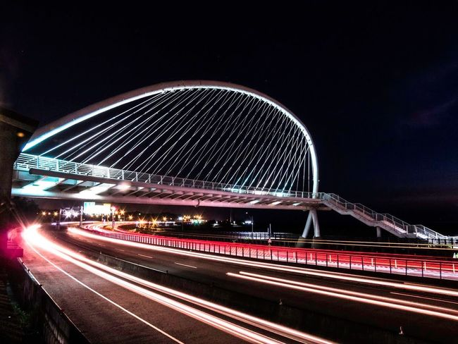 Hustle and bustle Bridge Night Light Trail Long Exposure Illuminated Speed Motion Blurred Motion Architecture Transportation Built Structure