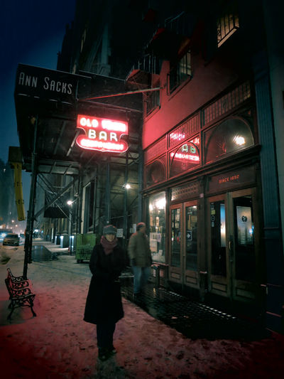 NEW YORK CITY - 2 FEBRUARY 2015: A woman walks in front of Old Town Bar, one of the oldest bars in New York City, in the snow. The pub remained open during Prohibition. Near Union Square, Manhattan. Adults Only Architecture Bar City Neon Neon Lights New York City New York City Bars Night Night Photography Nightlife Nighttime Nighttime Lights NYC NYC Photography Old Town Bar And Restaurant Outdoors People Pub Restaurant Snow Snowing Winter Woman