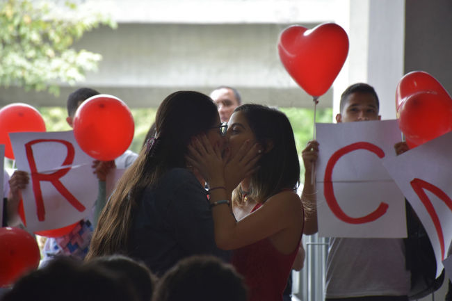 EyeEm Best Shots Hug Kiss NIKON D5300 Nikon Portrait Of A Woman Public Transportation Adult Balloon Celebration Day Gay Group Of People Lesbian Lifestyles Marriage  Men People Portrait Proposal Real People Red Togetherness Women women around the world This Is Queer