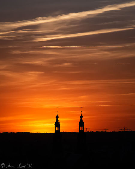 Orange sunset with towers silhouettes. Sunset Sky Orange Color Travel Destinations Nature Built Structure Silhouette Cloud - Sky Architecture No People Scenics - Nature Tourism Travel Building Exterior Building Outdoors Beauty In Nature Tower City Spire  Cityscape The Week on EyeEm EyeEmNewHere EyeEm Best Shots EyeEm Nature Lover