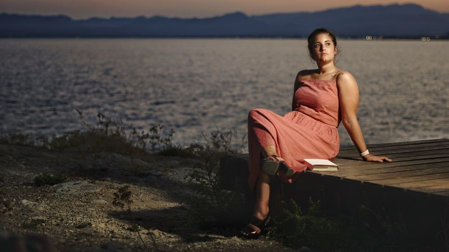 Portrait of woman on shore at beach