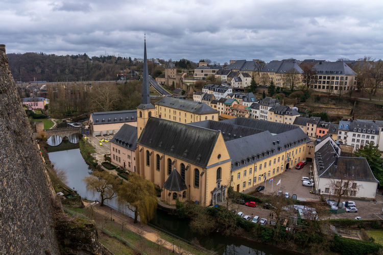 Abbey Neumünster in Luxembourg city. Luxembourg Abbey Neumünster Abbey Church Architecture Building Exterior Built Structure City High Angle View Cloud - Sky Sky Building Nature Residential District Cityscape History Day Tree No People The Past Transportation Road Town Plant TOWNSCAPE