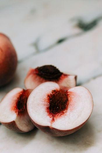 High angle view of halved peach on table