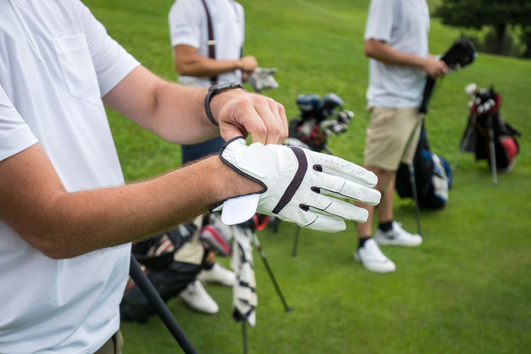 Midsection of man preparing for golf