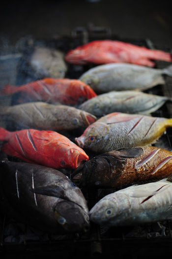 Fish Grilling On Barbecue At Market Stall
