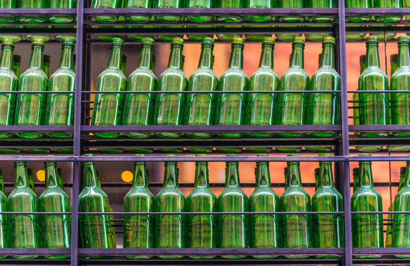 Arrangement Backgrounds Choice Close-up Conceptual Day Environmental Conservation For Sale Full Frame Green Bottles In A Row In A Row Industrial Itaewon Large Group Of Objects Multi Colored No People Outdoors Recycling Retail  Shelf Store Tree Variation