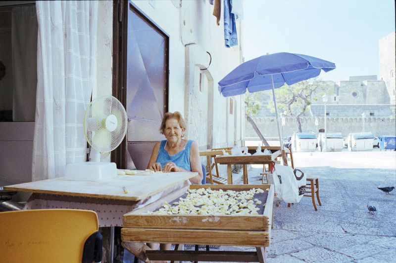 old woman making orecchiette in the street - Bari - Luglio 2017 Bari Puglia Puglia South Italy Adult Blond Hair Chair Day Foodporn Holding Old Woman One Person One Woman Only Only Women Orecchiettepugliesi Outdoors Pasta People Real People Sitting Street Streetphotography Summer Table Typical Food Women An Eye For Travel Colour Your Horizn Colour Your Horizn My Best Photo